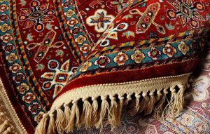 What are Persian carpets which are hand woven?